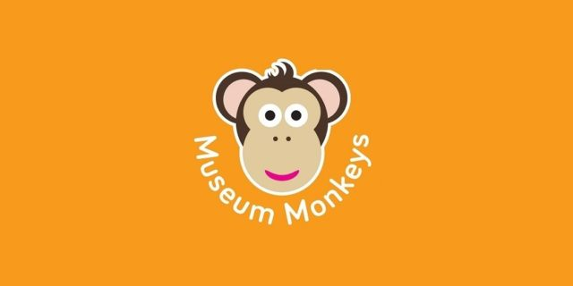 Cartoon monkey face against yellow background