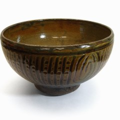 YORYM : 2004.1.509 - Michael Cardew, Earthenware bowl (1970) with a tenmoku and ash glaze. Currently on display in the Wall of Pots, CoCA.