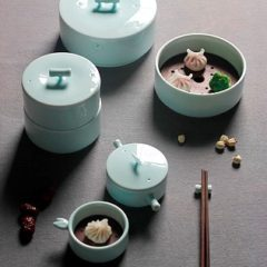 Series of blue ceramic lidded pots containing food