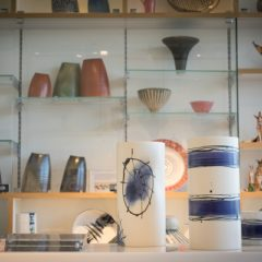 Two white and navy striped vases in a ceramics shop