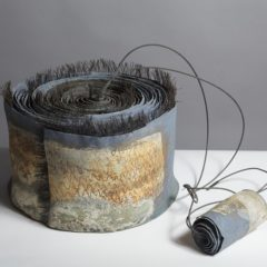 Abstract ceramic sculpture with wire