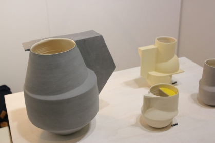 A collection of ceramic objects. Each one is a different shape, size and colour.