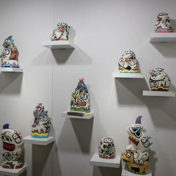 Ceramic objects with cartoon animals drawn on them.