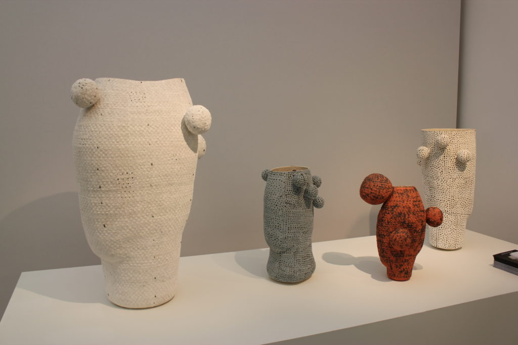 Four ceramic objects. Two are white, one is blue and one is brown.
